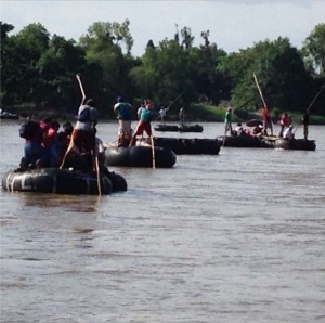 Illegal Aliens tubing across Rio Grande