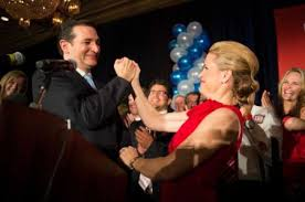Ted and Heidi grasping victory hands