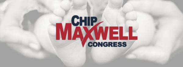 Chip Maxwell sign against baby feet